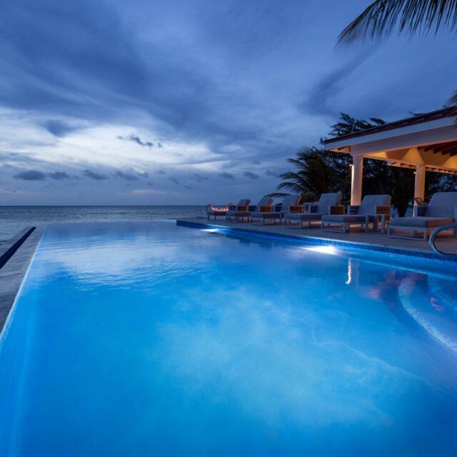 The pool at night at Manta Island, Belize